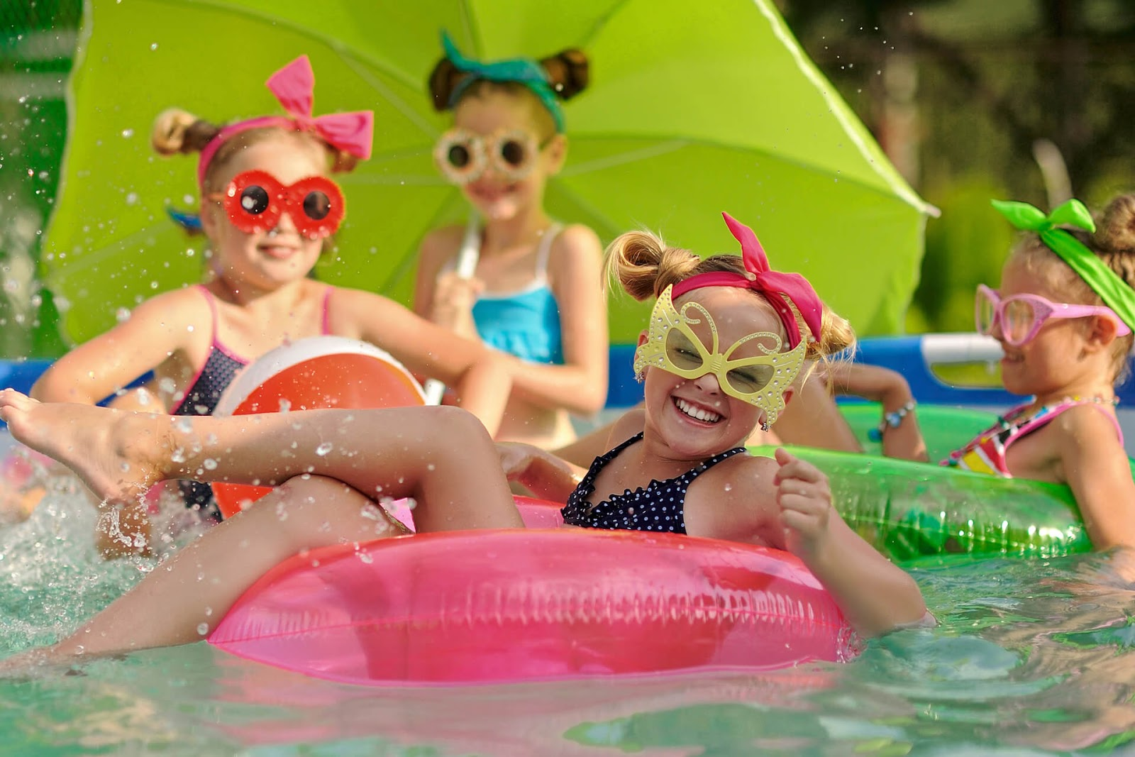 Group of girls having fun in the pool