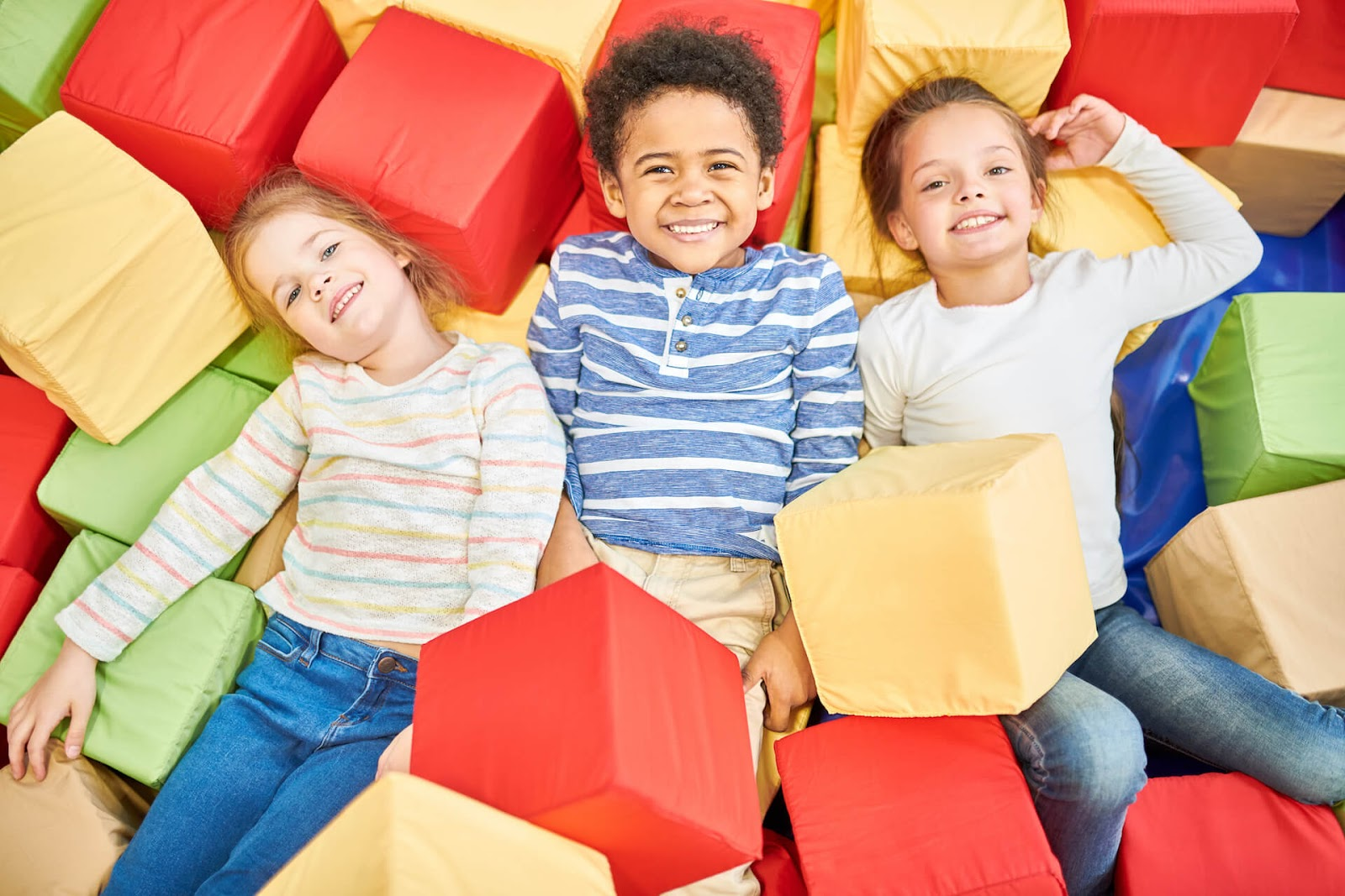 Kids enjoying a foam pit at a birthday party