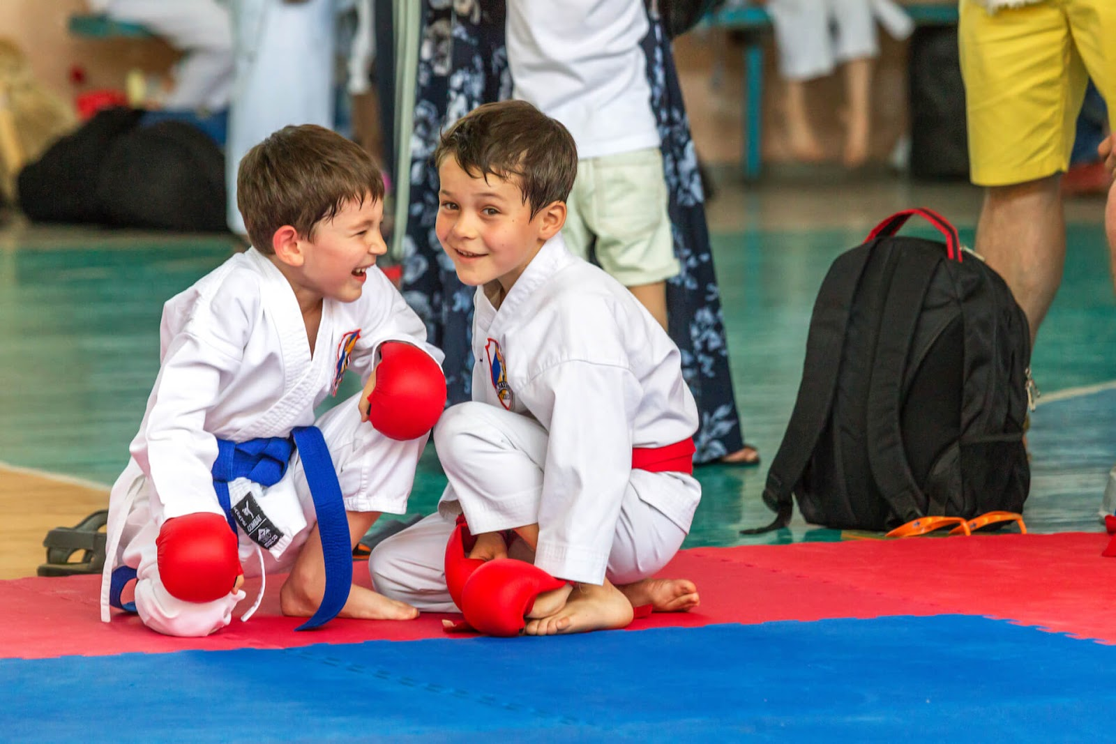Two boys in karate gear laughing