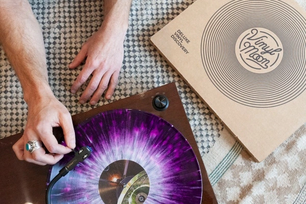 Hand putting a pretty cool looking record from Vinyl Moon on