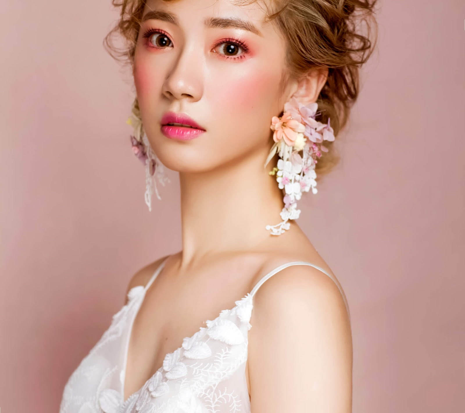Bride in floral statement earrings