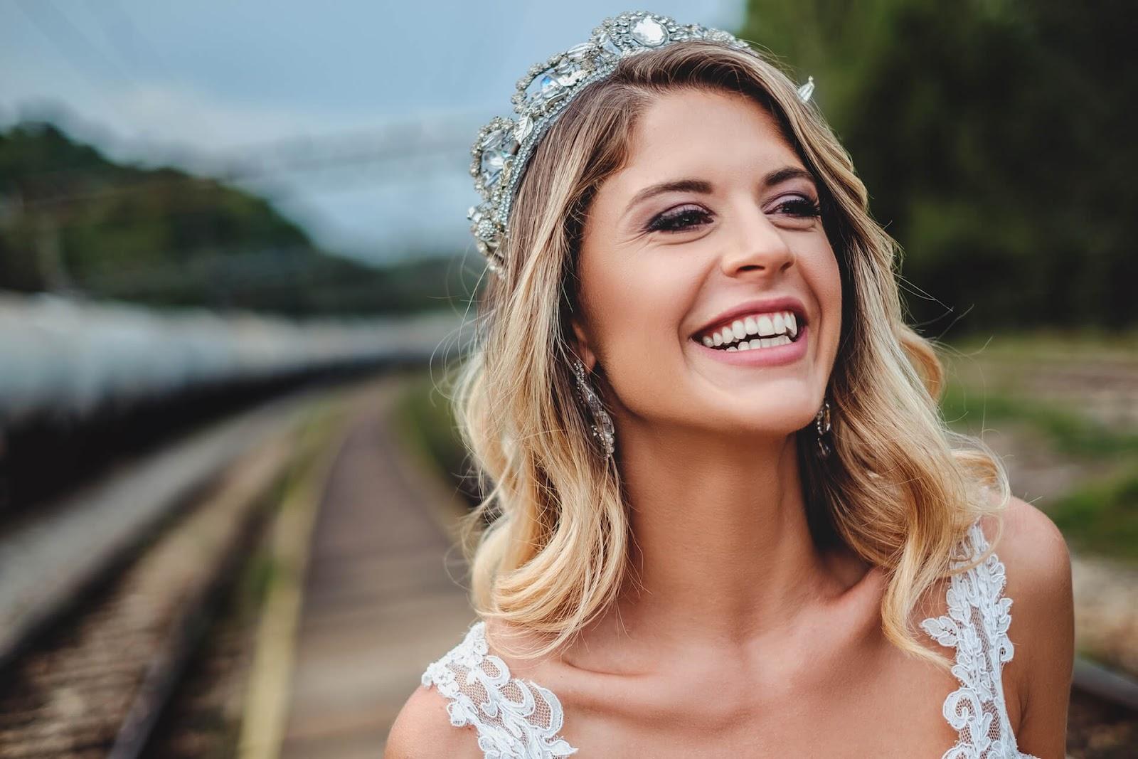 Bride wearing a tiara and smiling
