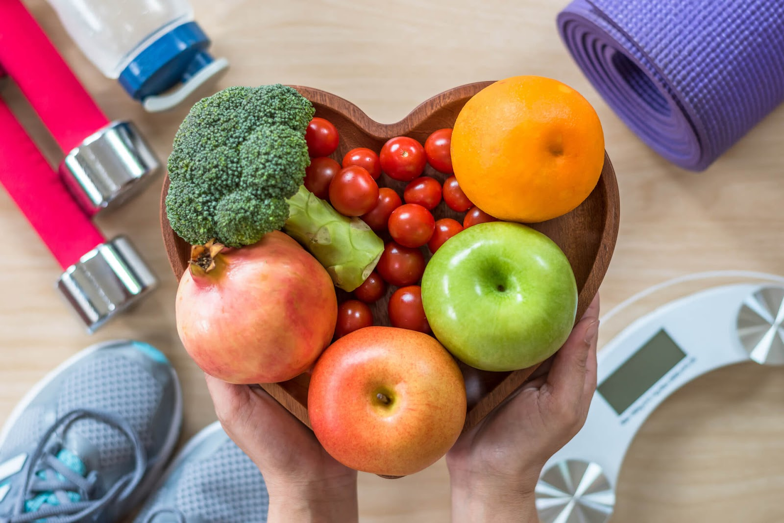 heart shaped bowl of fruits and veggies