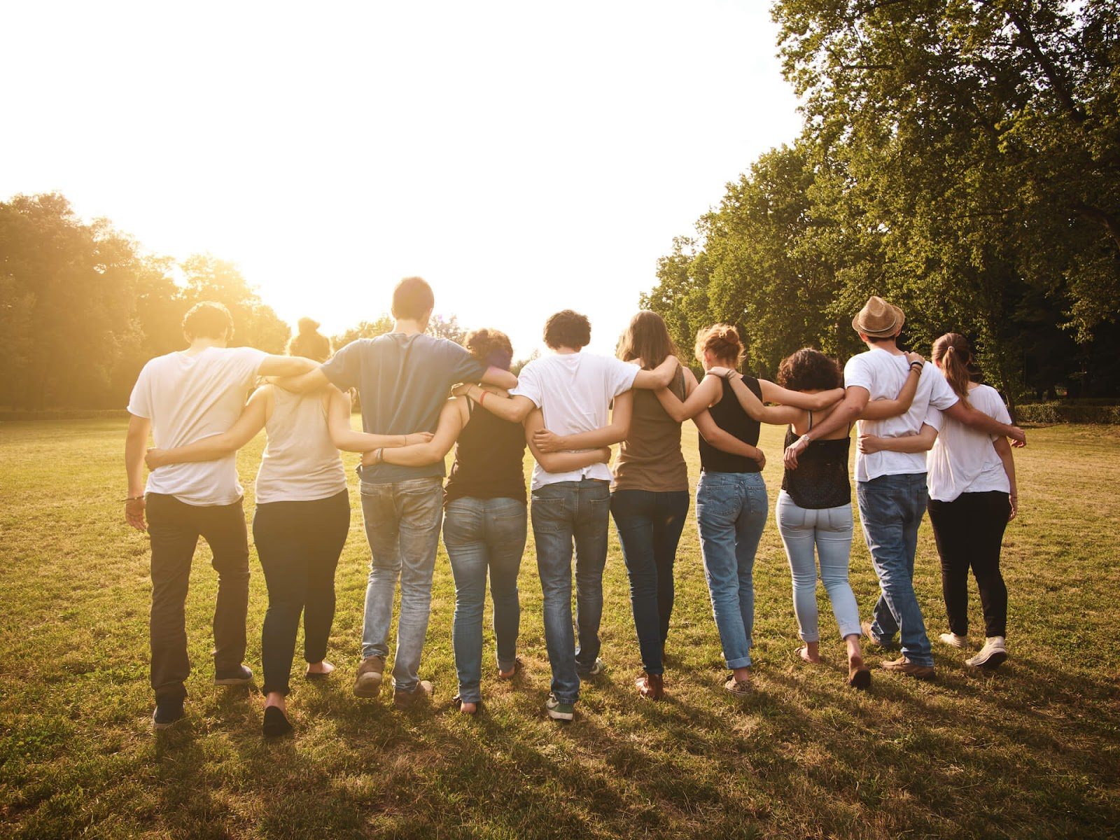 Group of friends waling with arms around each other