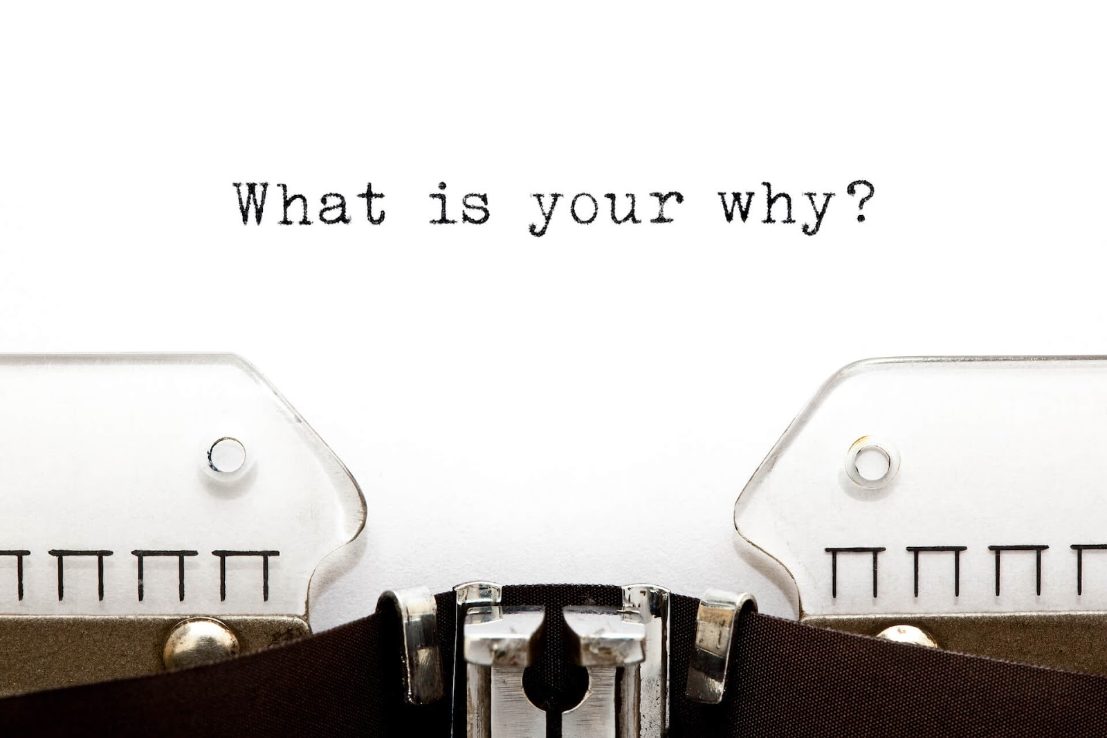 """Type writer with """"what is your why?"""" typed onto paper"""