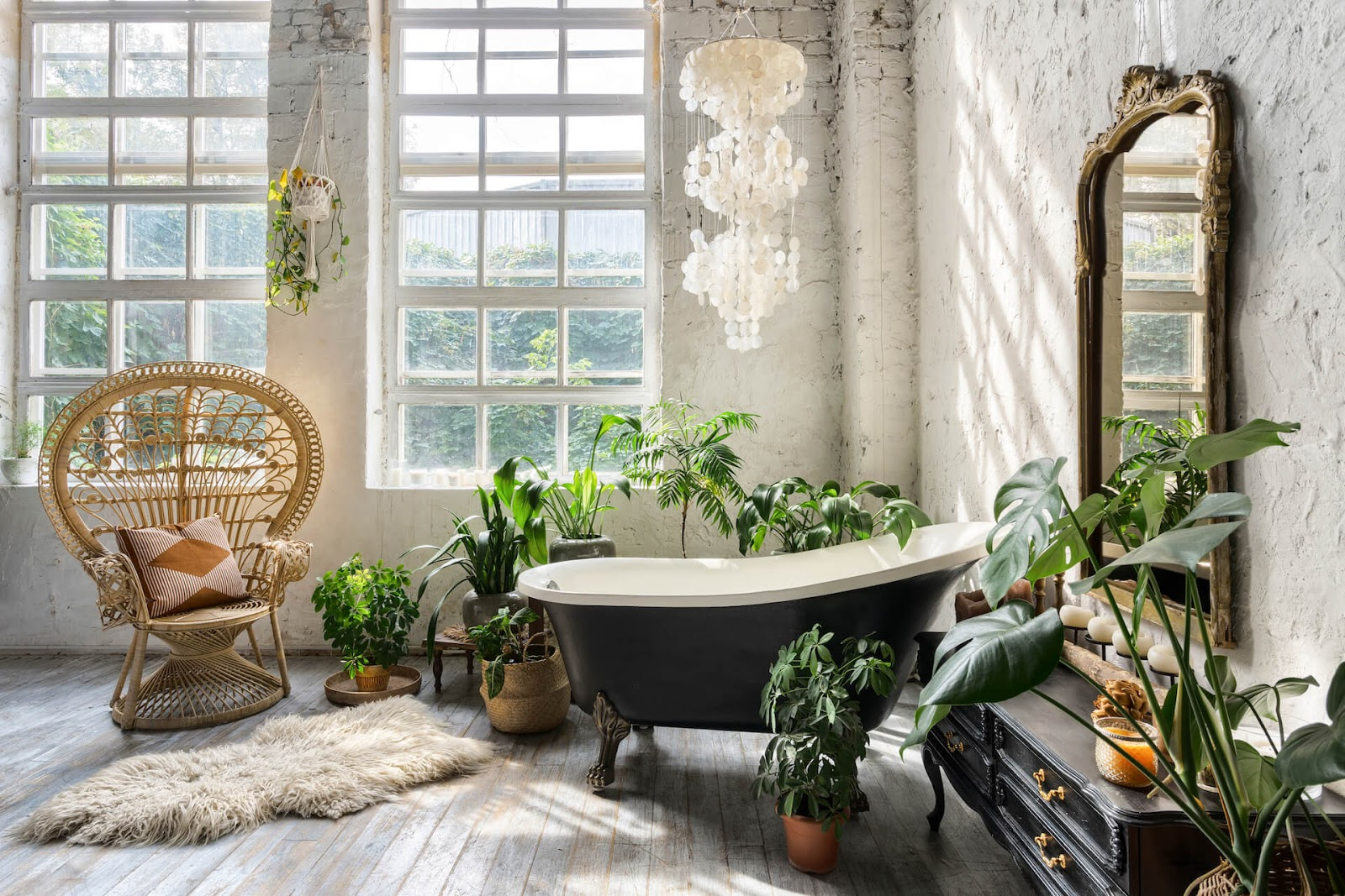 Shell chandelier over tub in bathroom