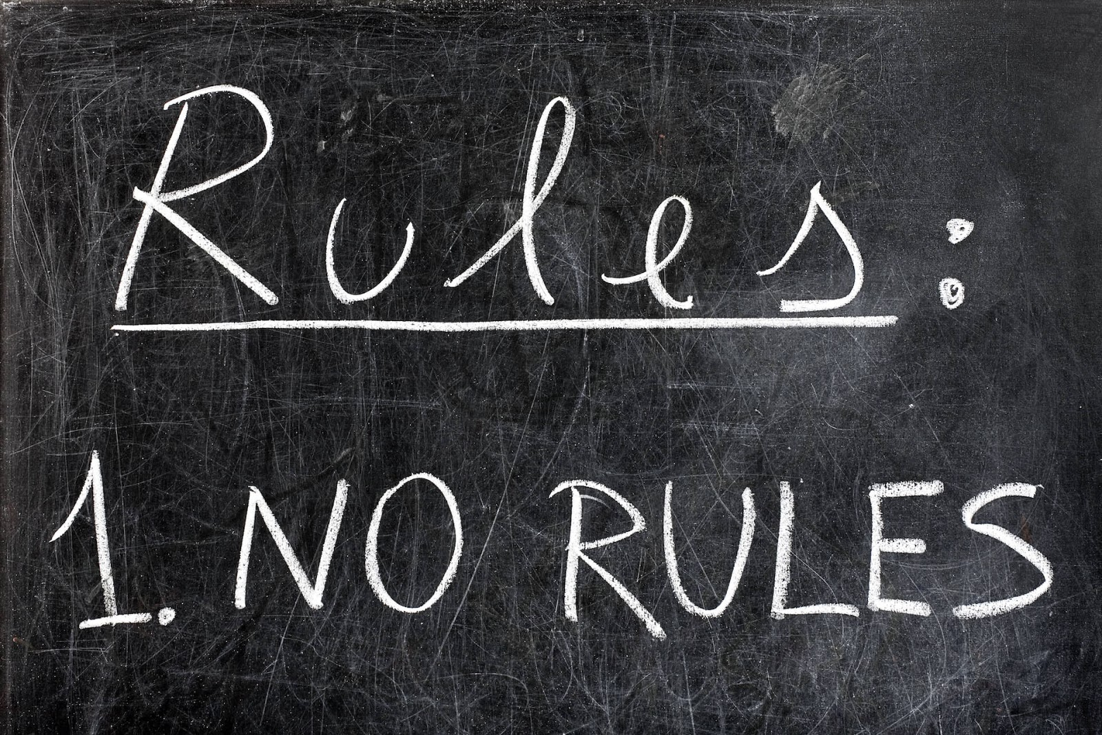 "Blackboard with ""Rules: 1. No Rules"" written on it"
