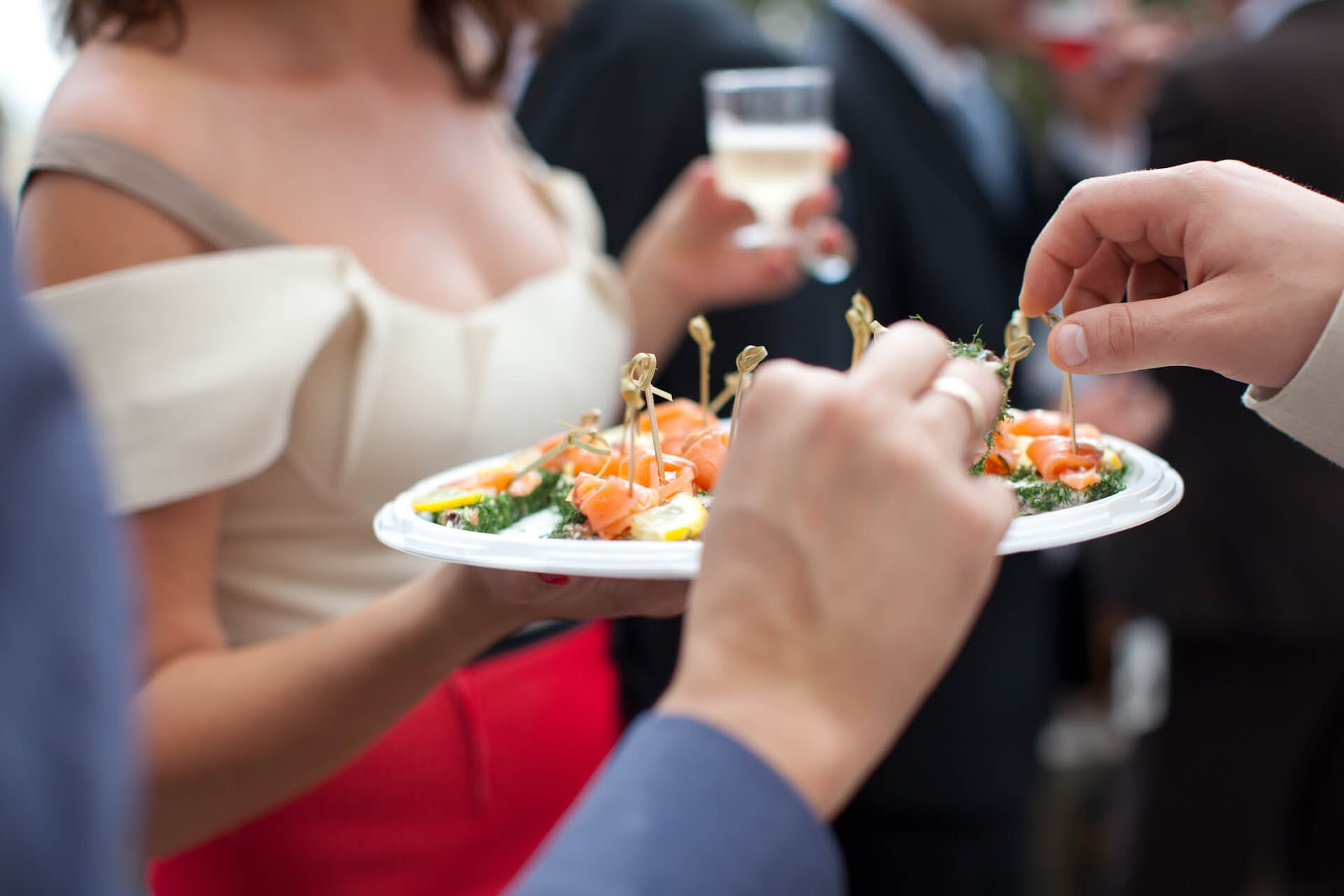 Caterer passing out appetizers