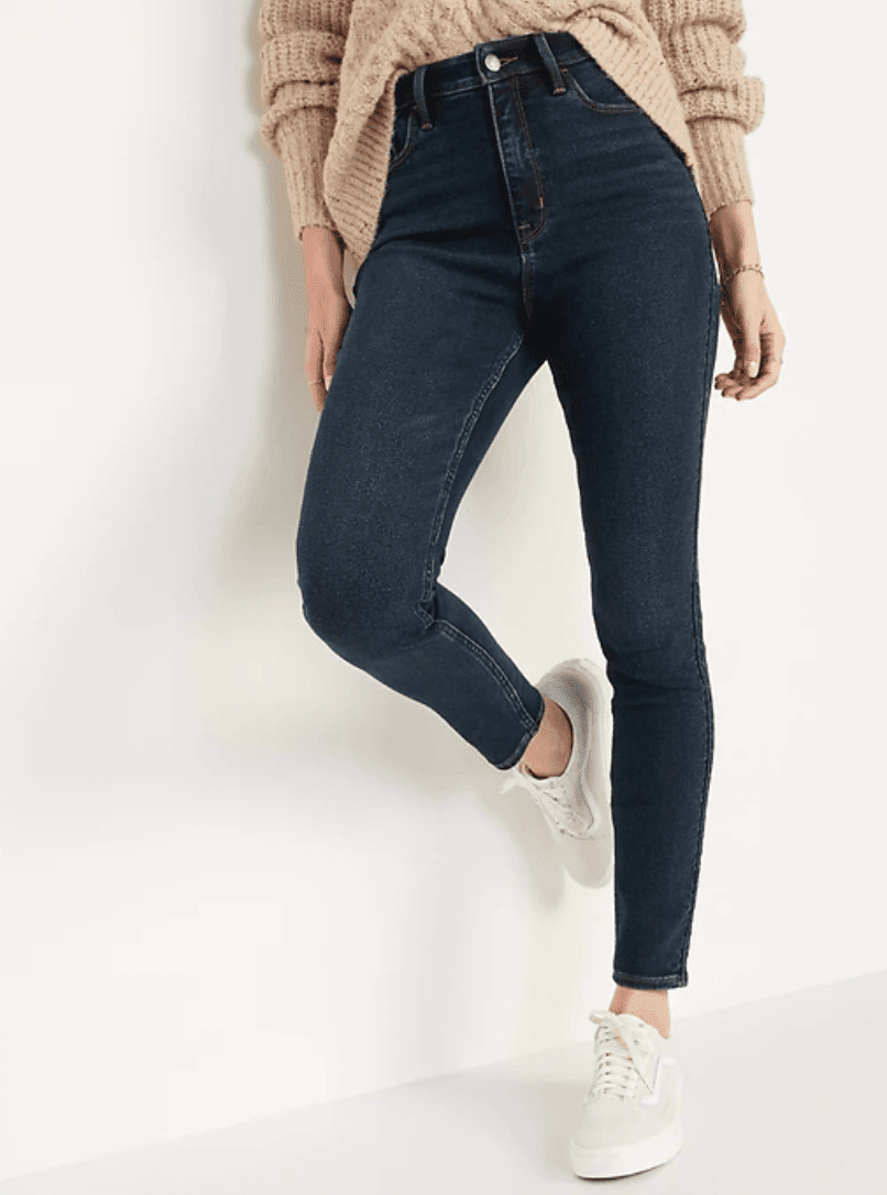 Extra High-Waisted Rockstar Skinny Jeans with sweater tucked in