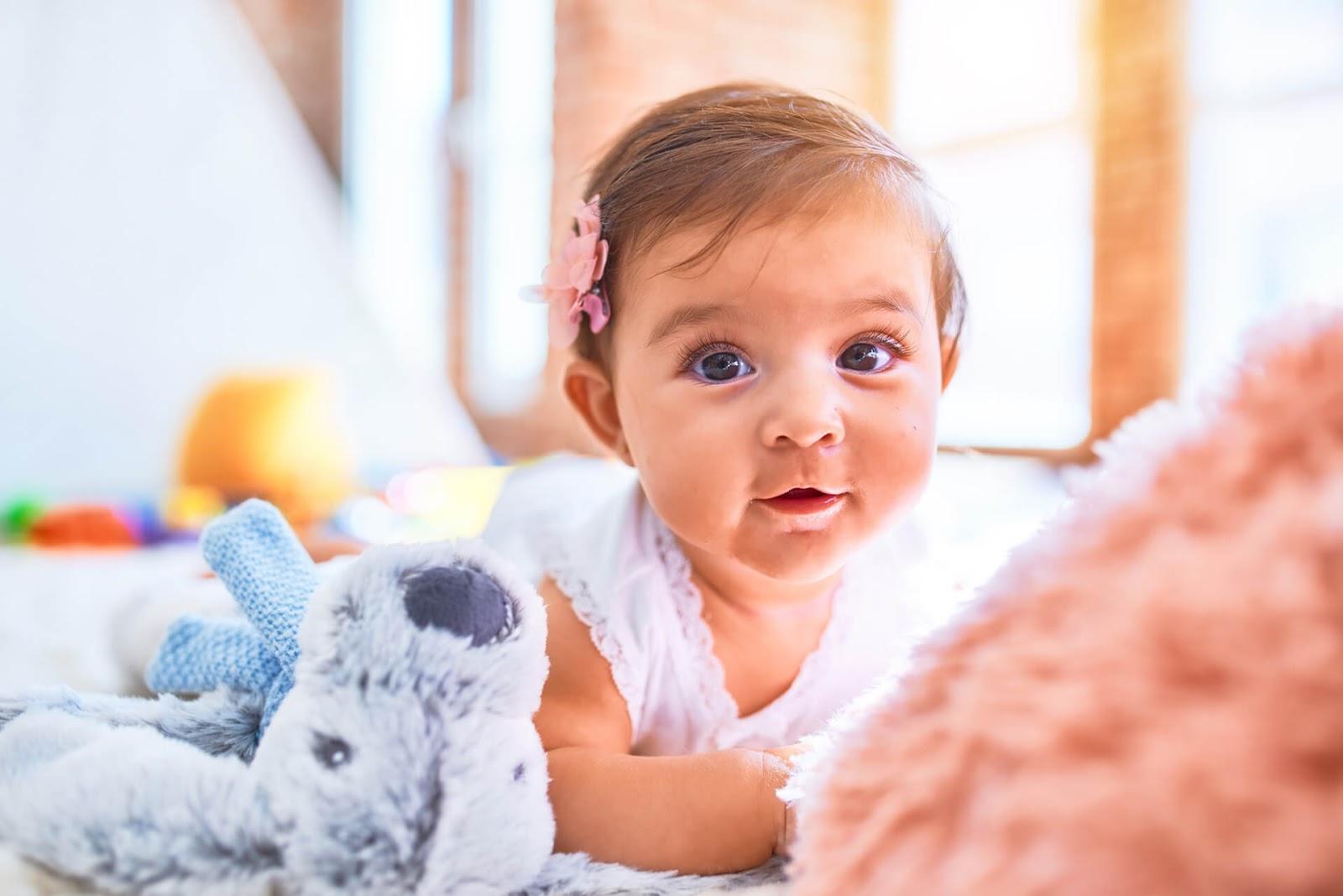 Brown eyed baby girl looking at the camera