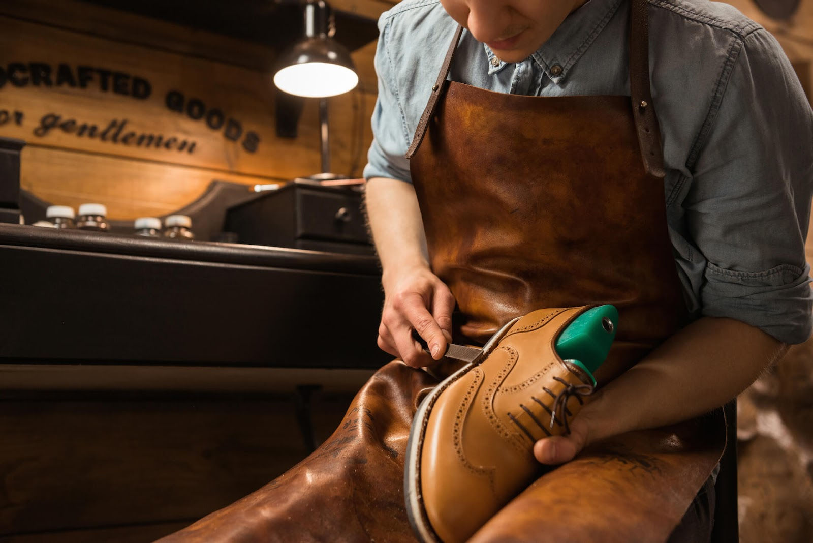 Man repairing nice leather shoes