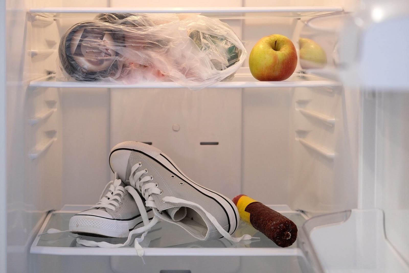 Some grey converse sneakers in the freezer