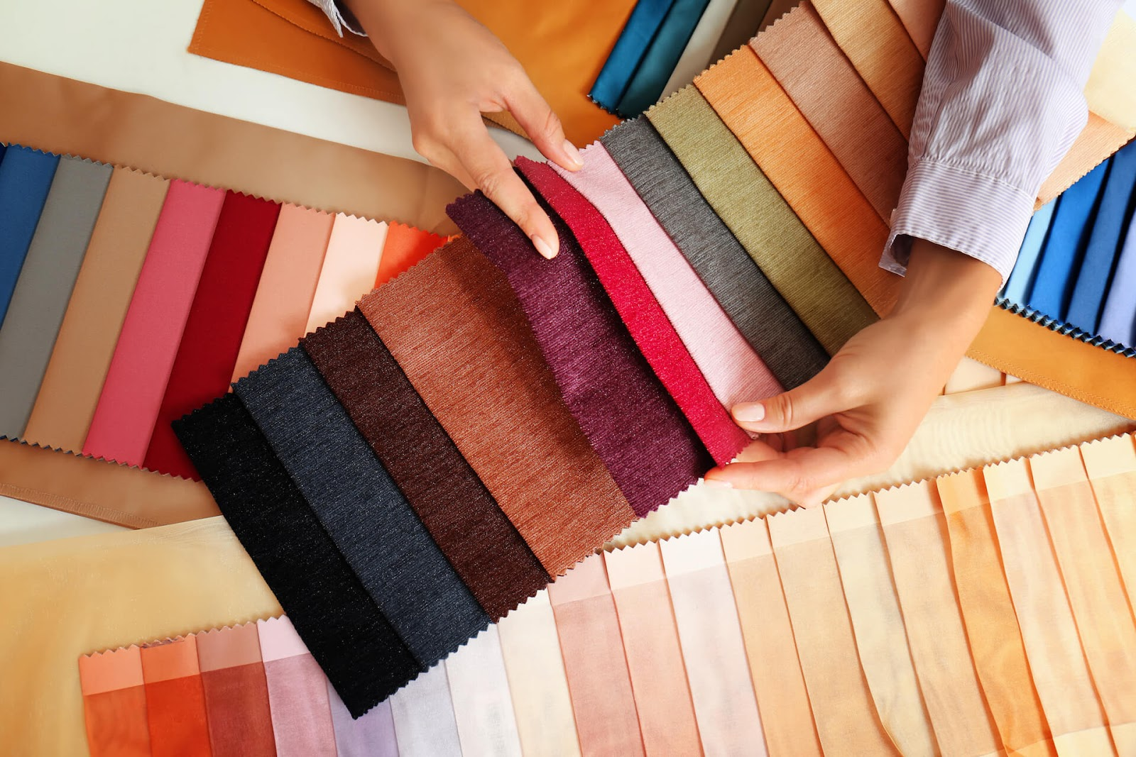 Woman looking at fabric swatches