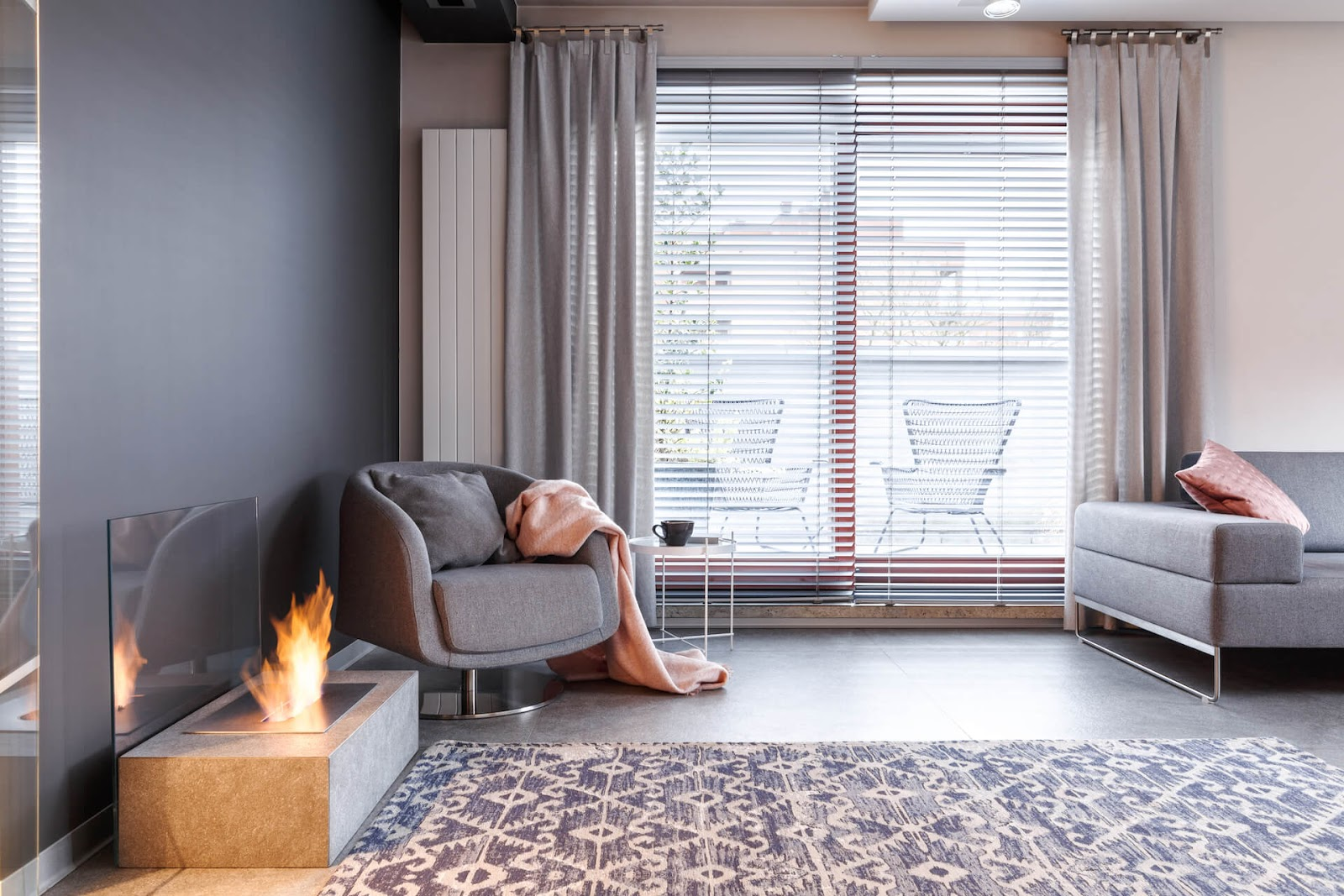 Modern living room with fireplace and stationary curtain panels