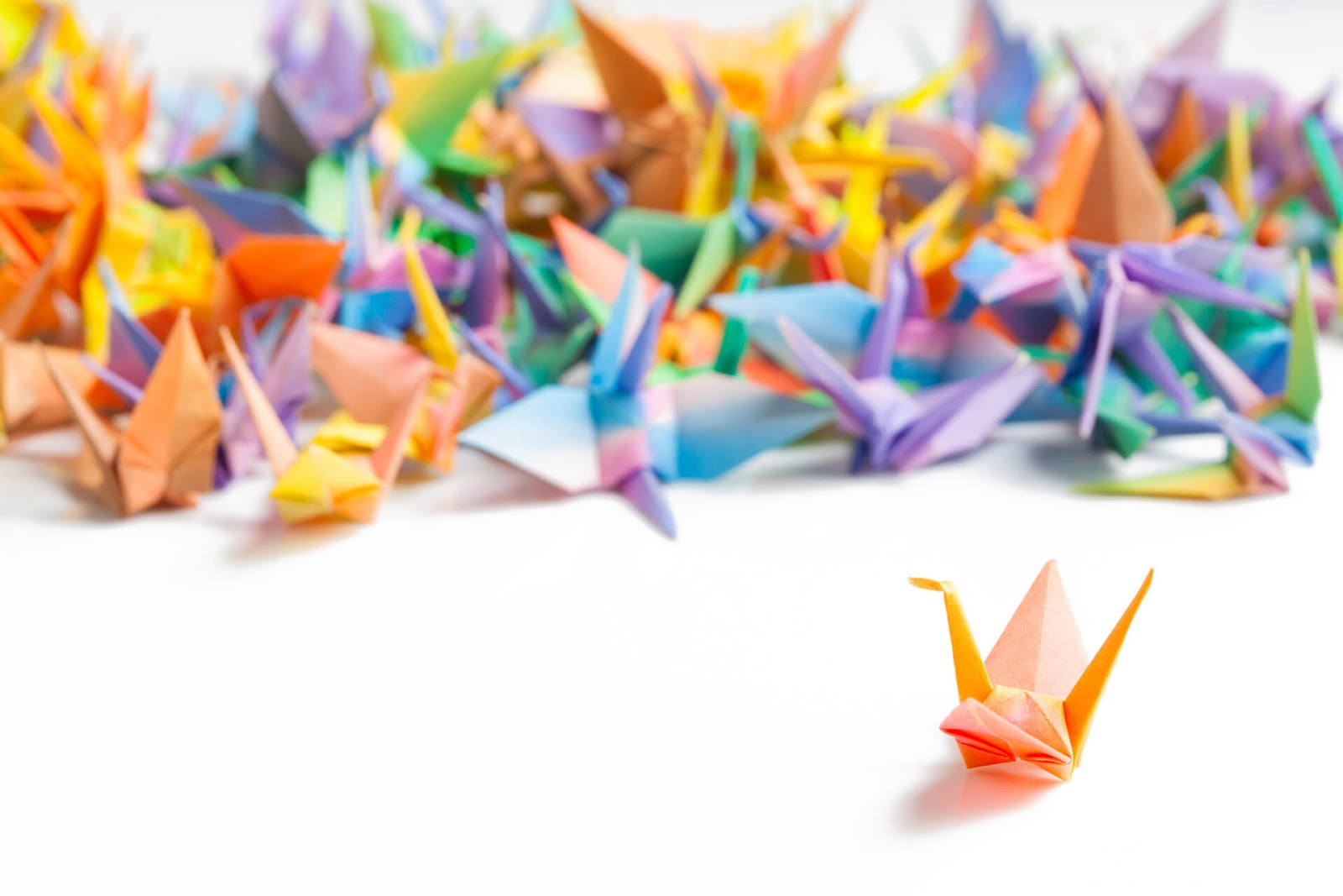 A whole bunch of colorful origami swans