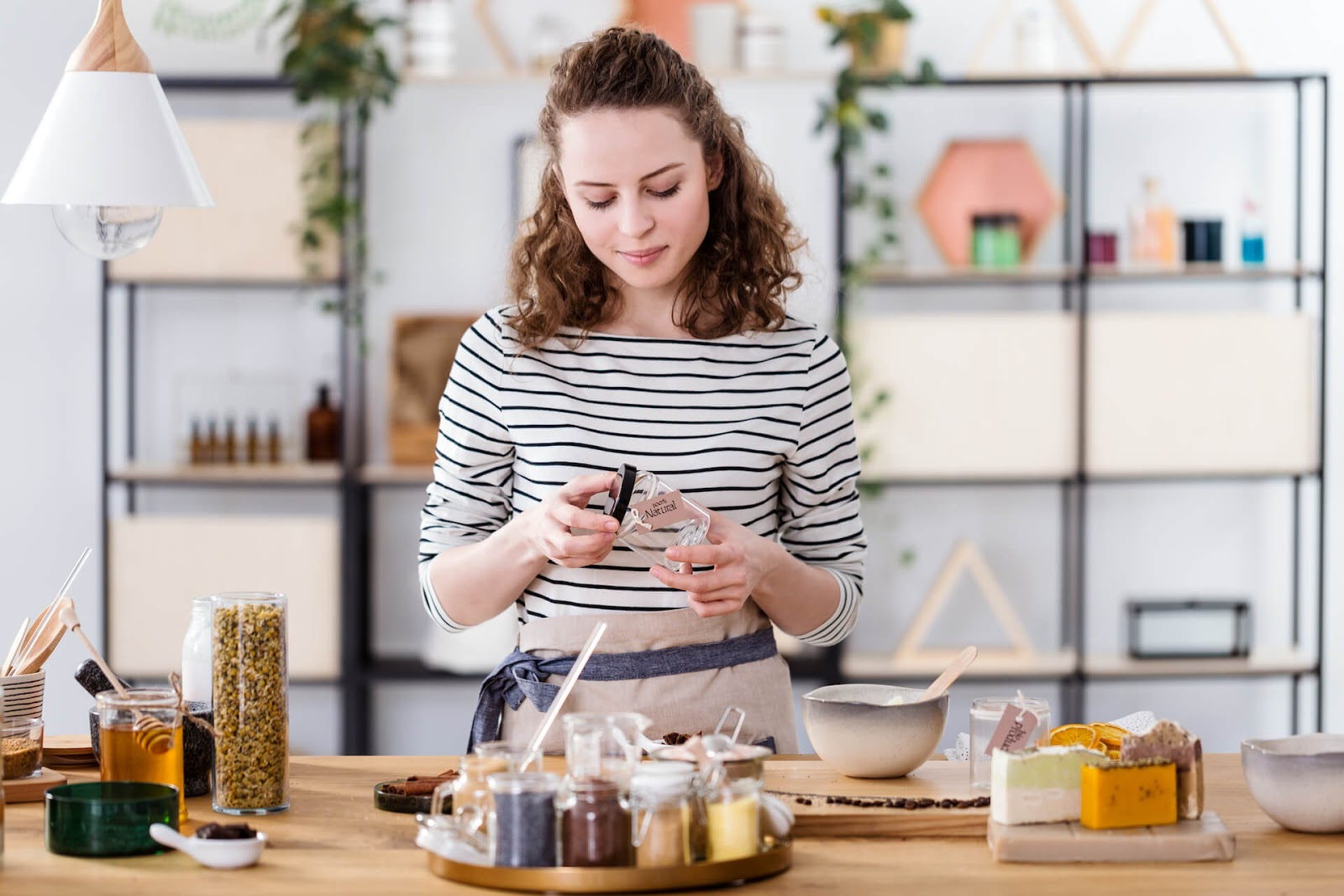 Woman making some homemade beauty products as a hobby in her living room