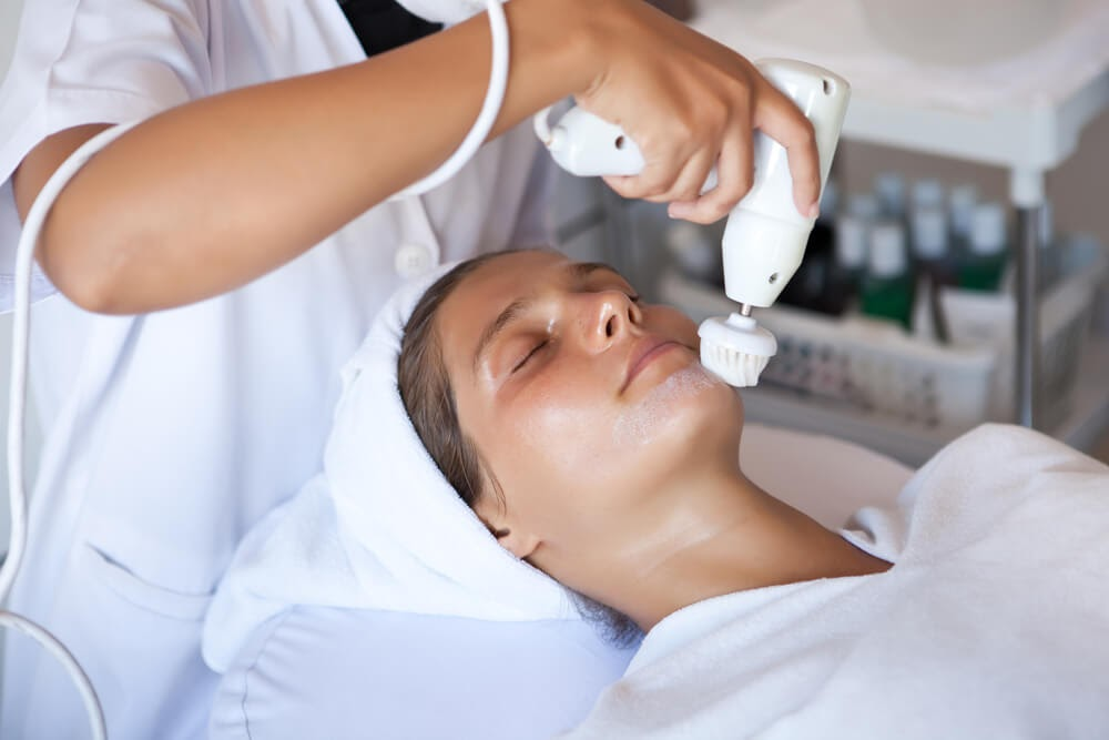 Woman getting an acne-fighting treatment done at a salon