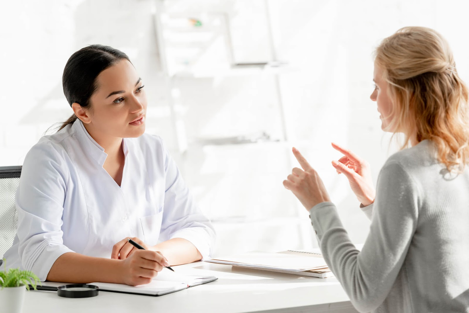 Woman chatting with her dermatologist