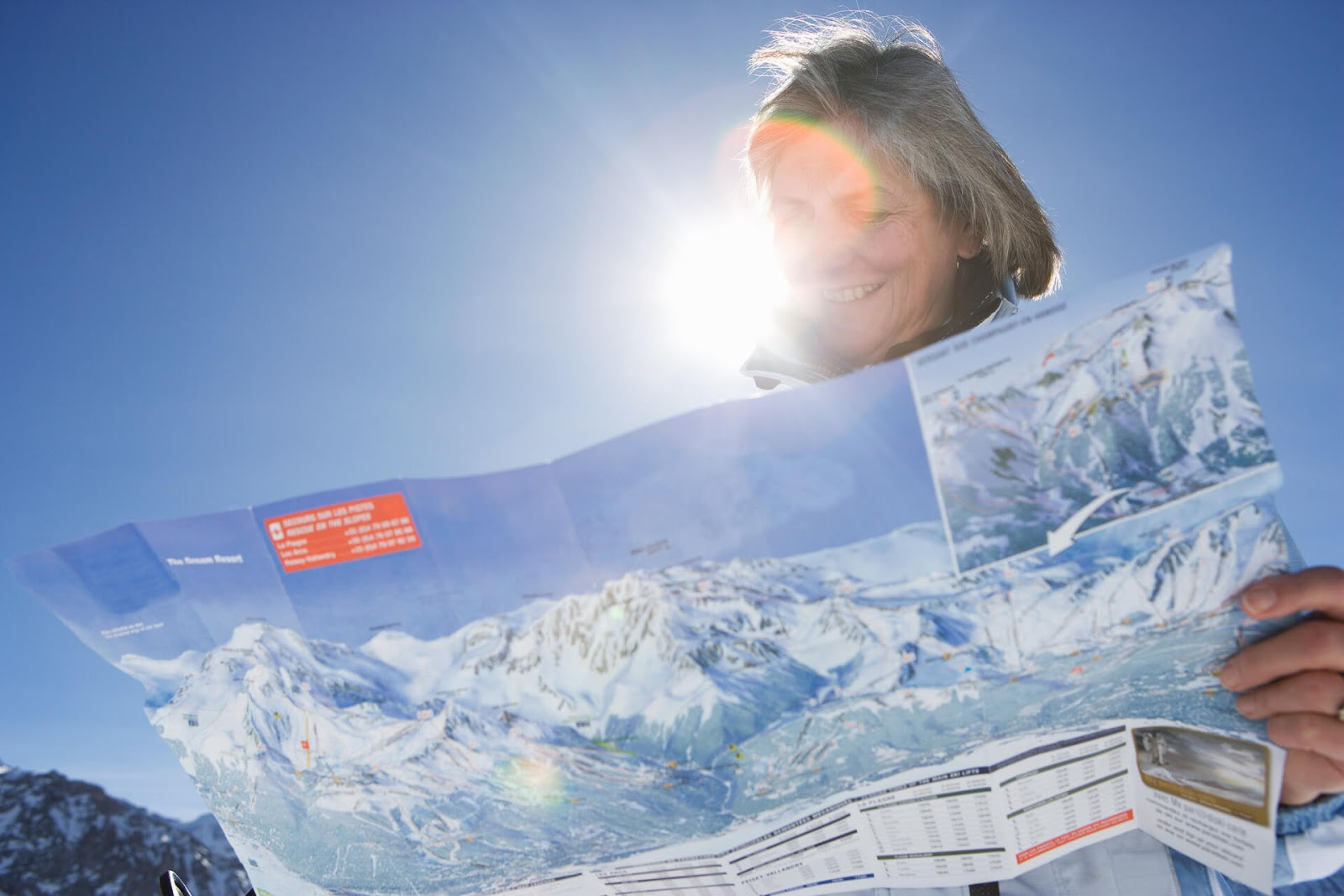 Woman looking at a trail map