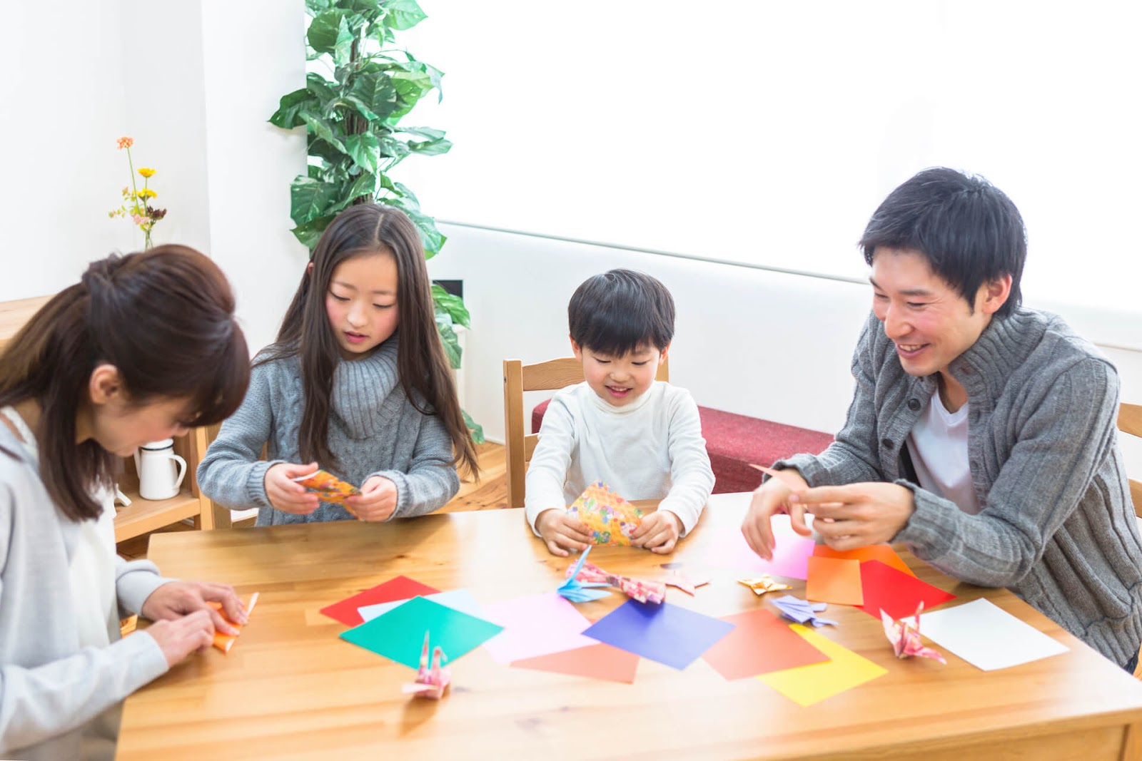 Family learning origami together
