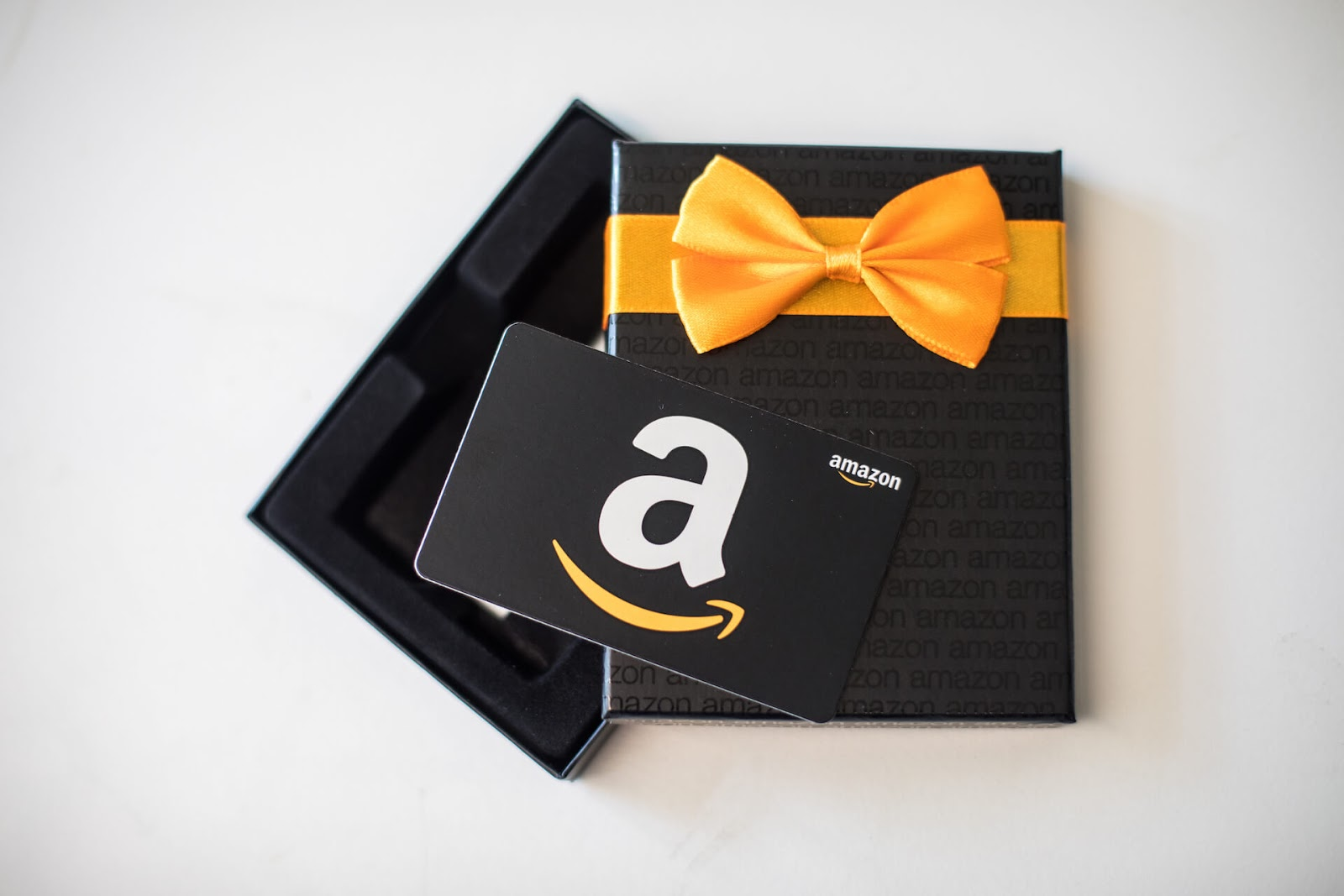 Box with an Amazon gift card in front of it