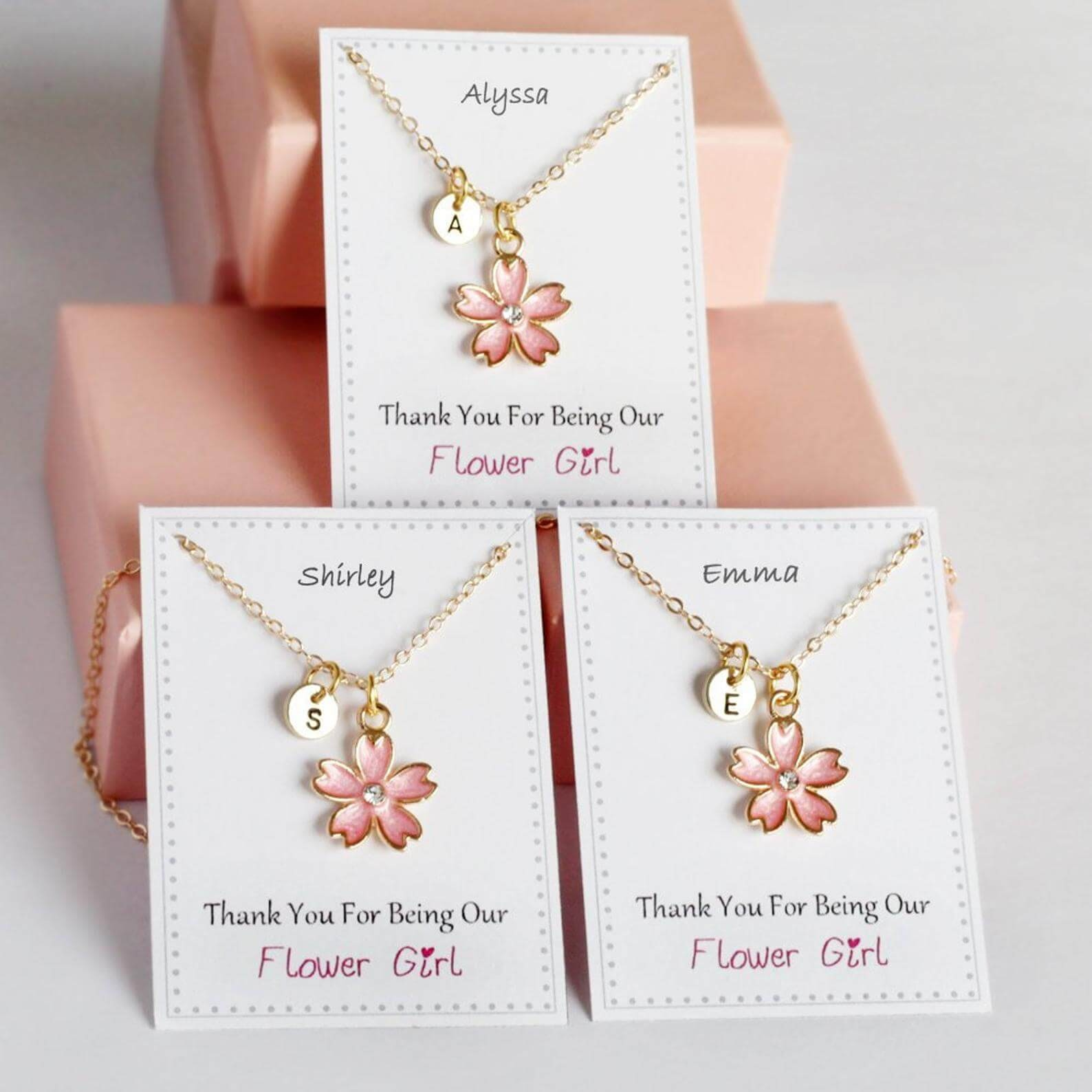 """Toddler bracelet with a flower on a display that says """"Thank you for being our flower girl"""""""
