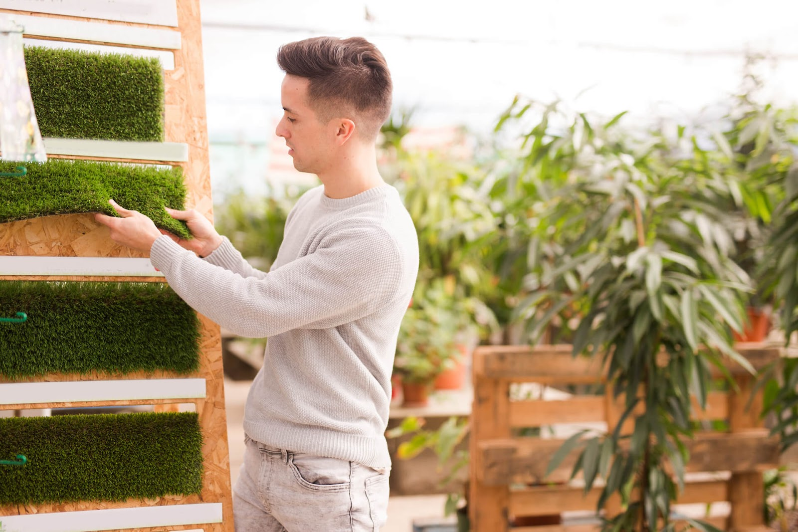 Man looking at artificial grass options