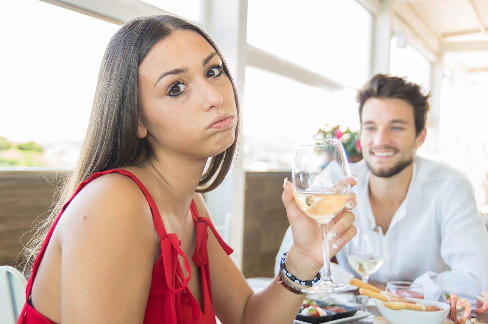 Woman with bored expression on a date