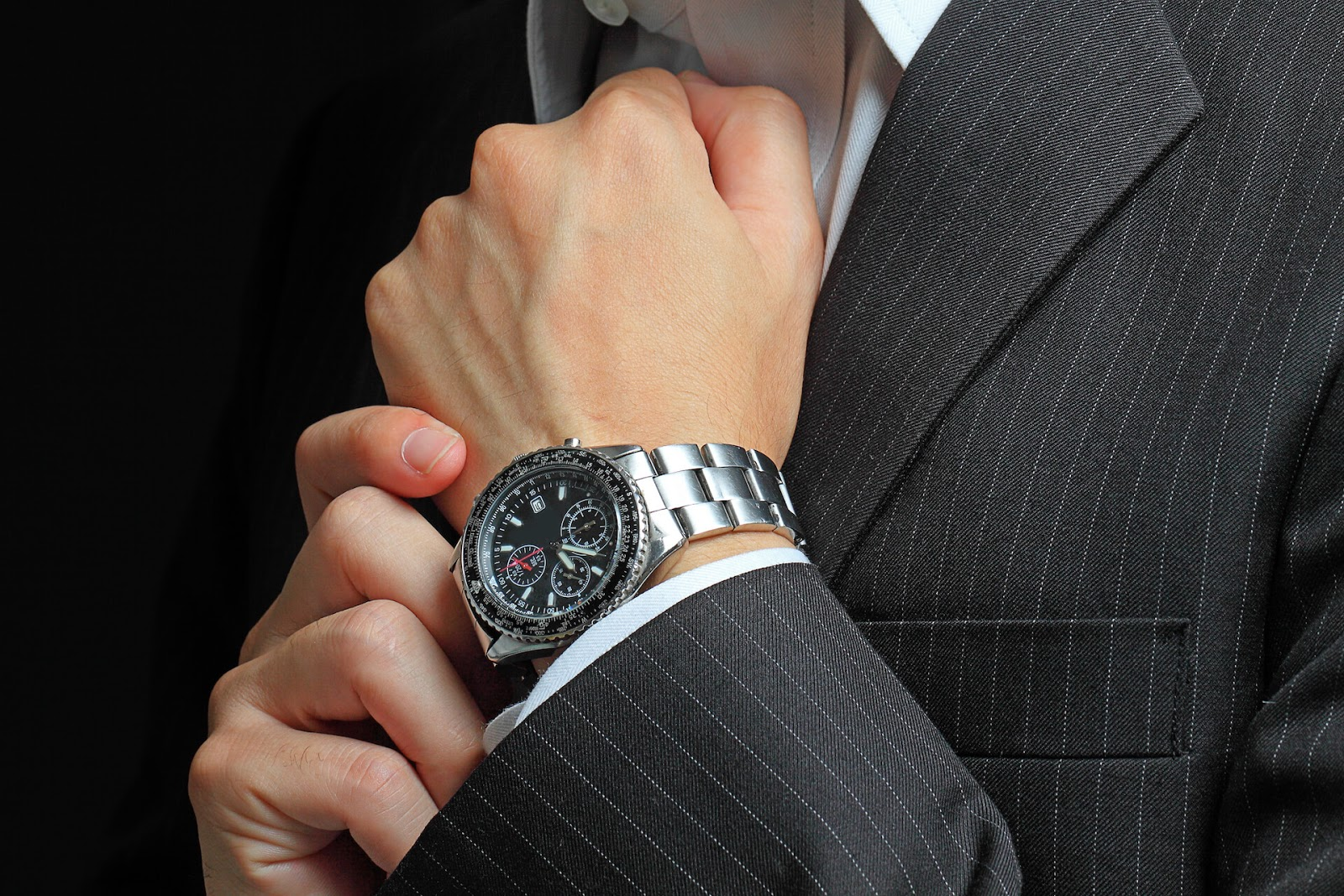 Man with dress watch on his hand