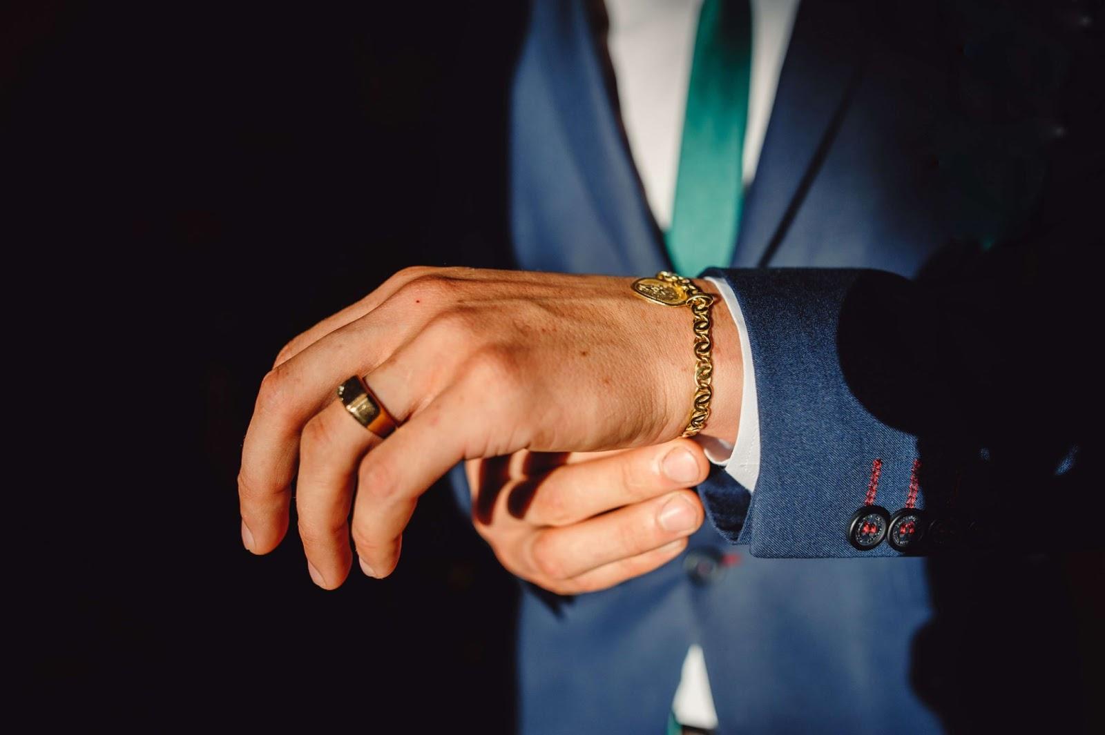 Man putting on bracelet