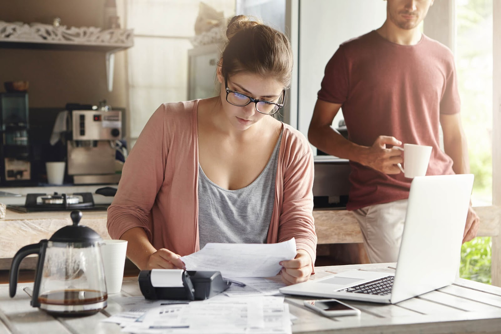 Woman looking over their budget to see if she can afford to be a stay at home mom