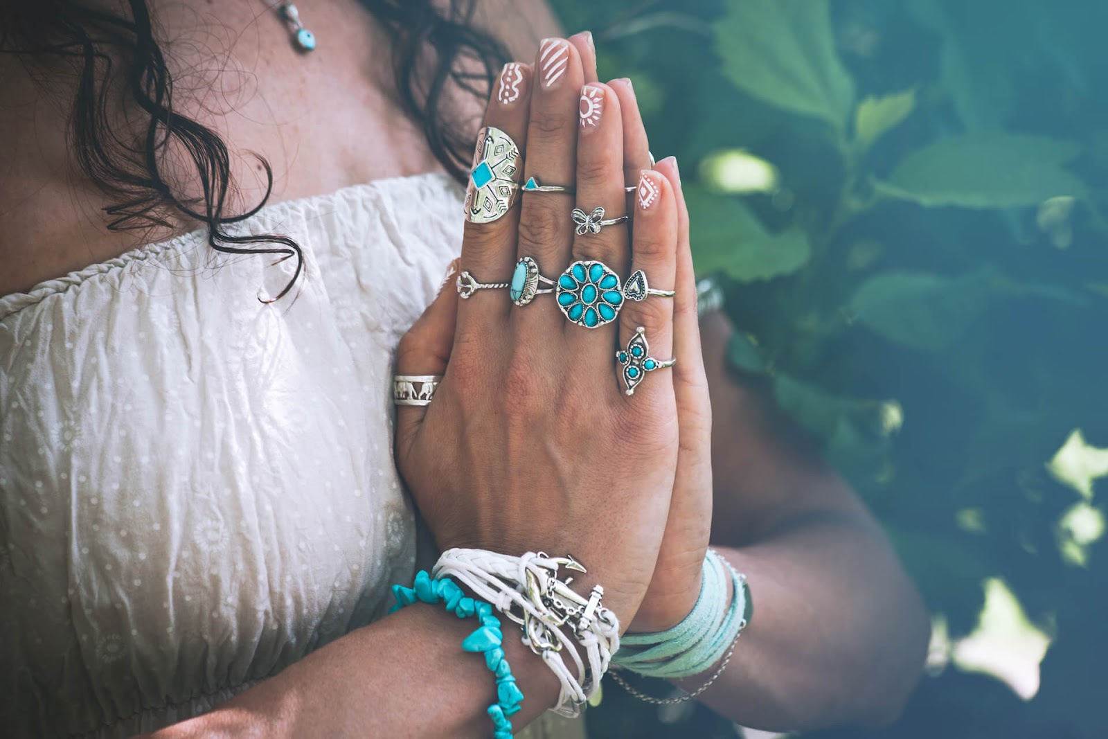 Close op of woman's hands as she meditates