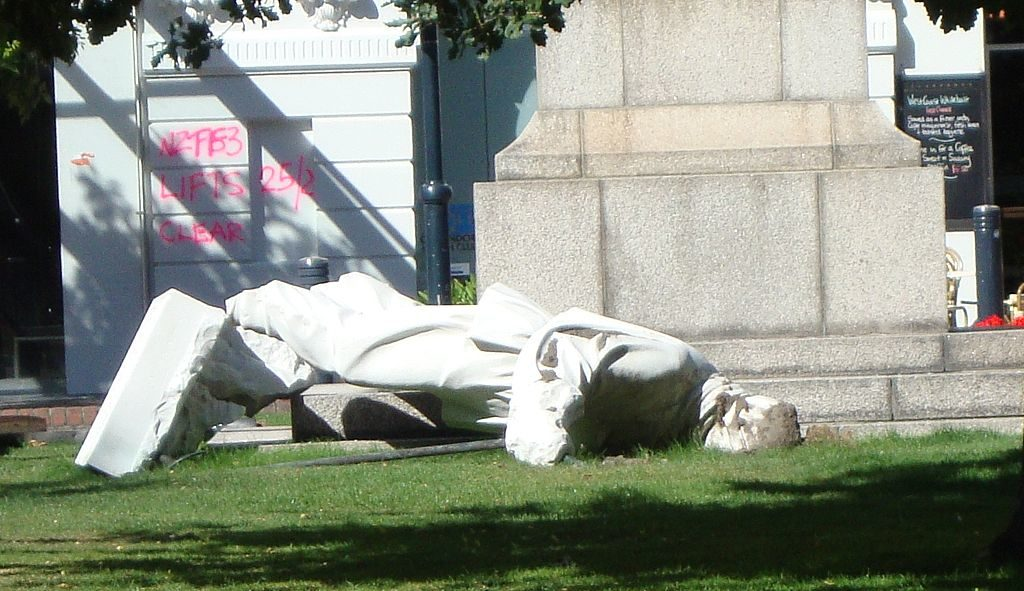 Photograph of a fallen statue of Antarctic explorer Robert Falcon Scott pitched off its plinth by the February, 2011 Christchurch earthquake
