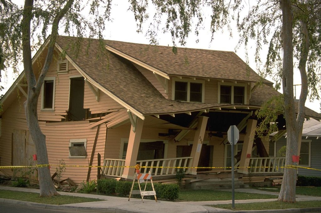 Photograph of a destroyed Los Angeles house in the aftermath of the January 17, 1994 Northridge Earthquake
