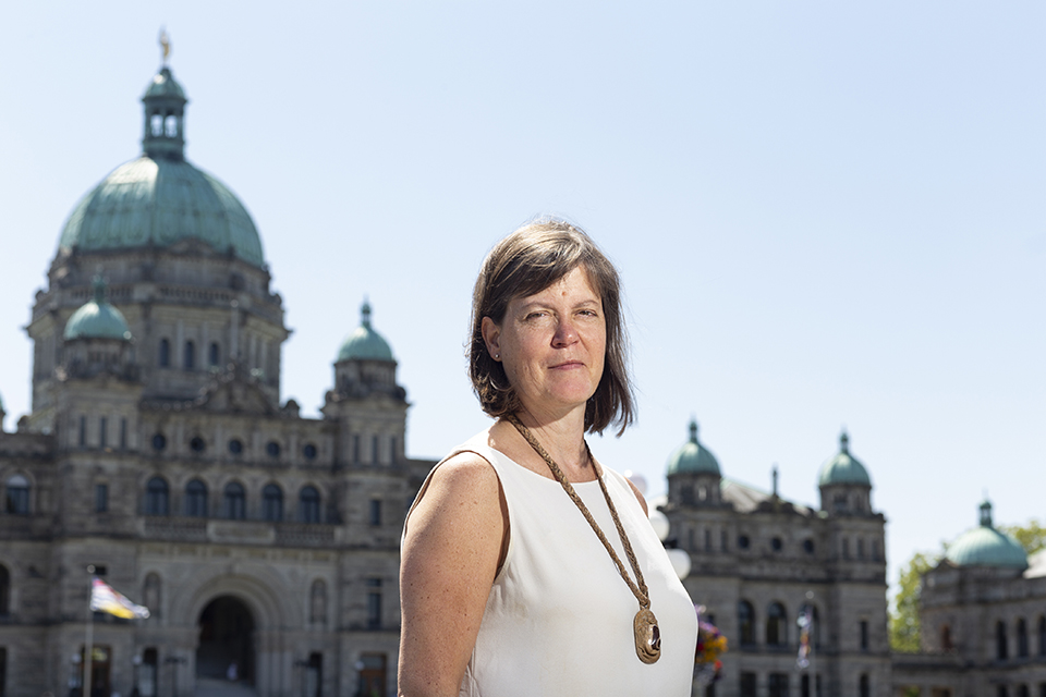 Penny Bryden stood in front of British Columbia Parliament Buildings.