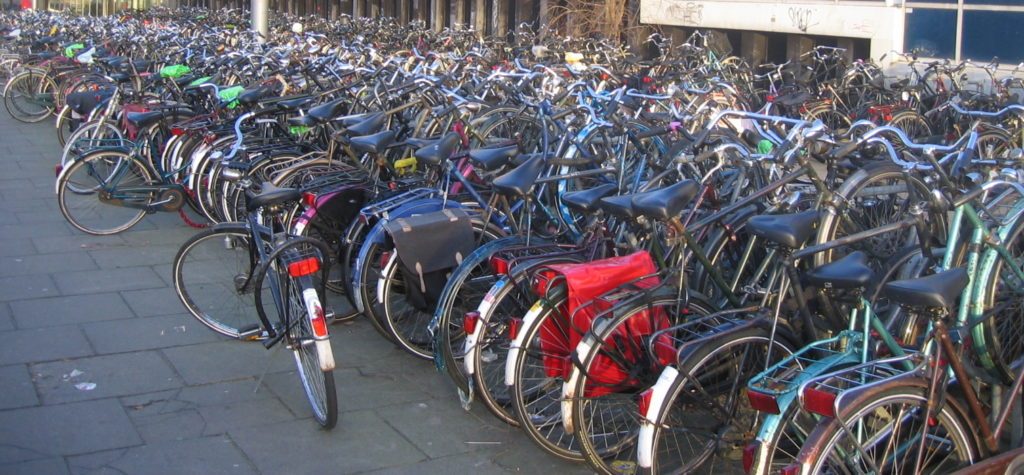 Hundreds of bikes stored tightly packed together forming several rows.