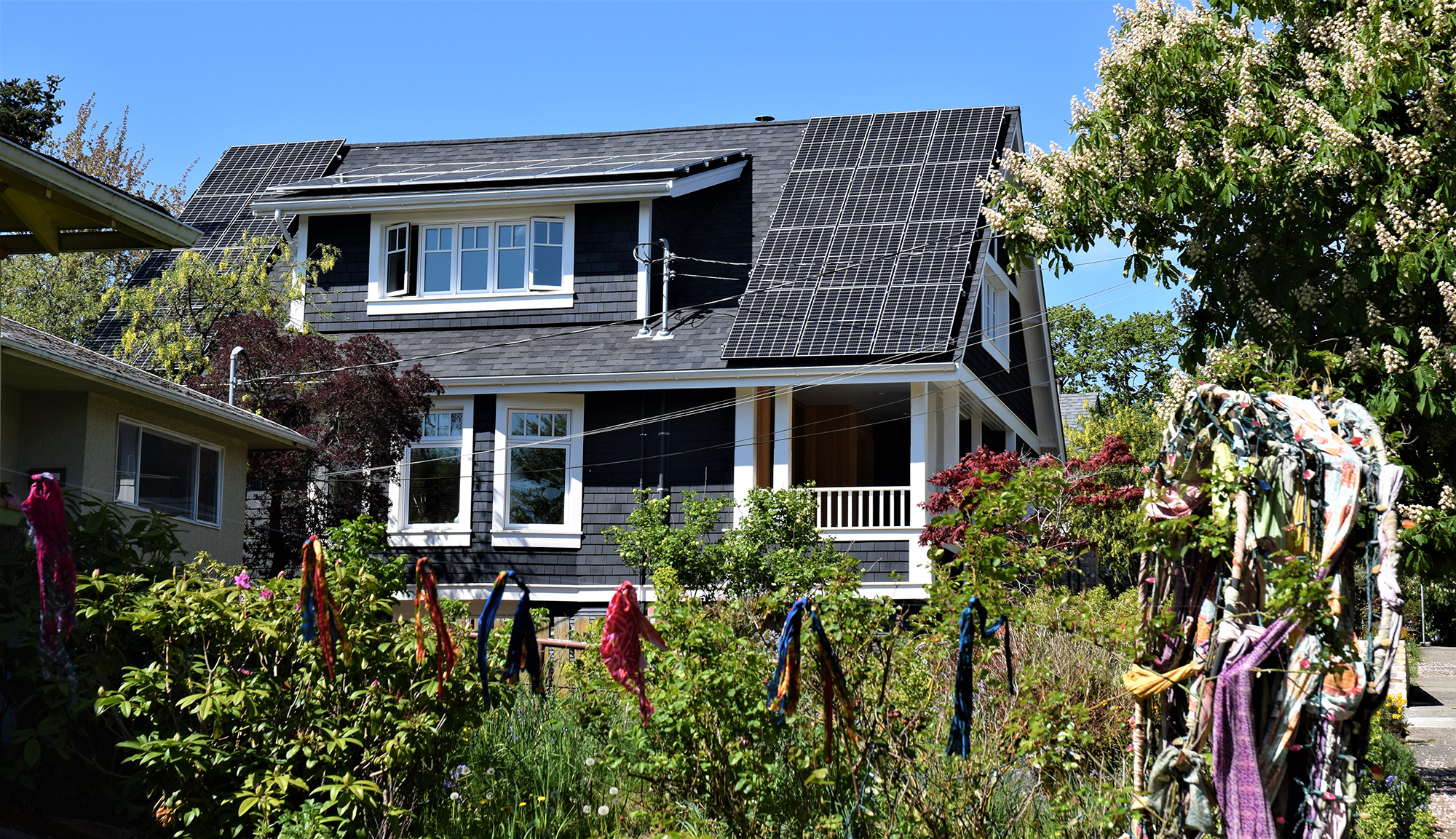 The exterior of the house with solar panels on the roof.