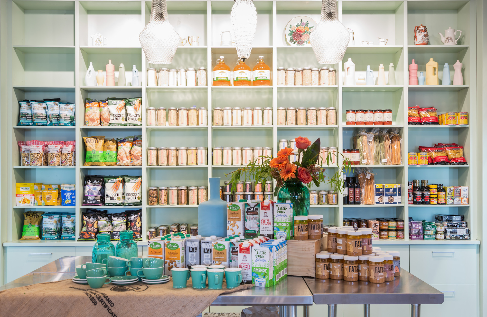 A general store with shelves lined with products.