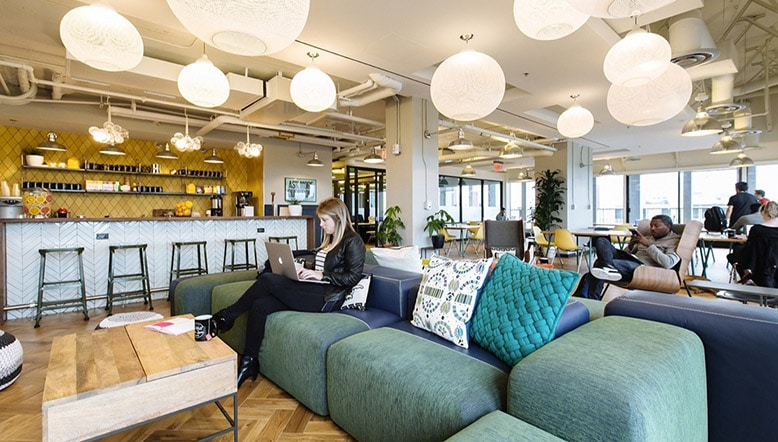 People having a break in an office space.