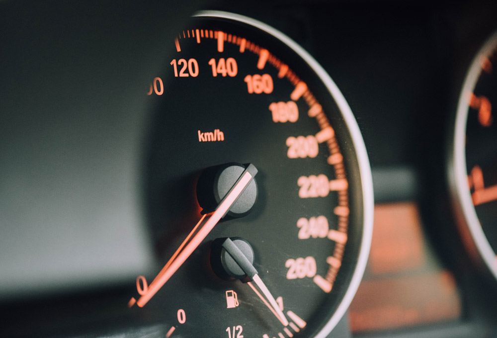 Car speedometer on dashboard
