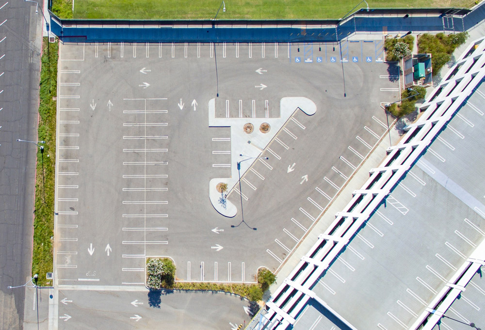Aerial view of square empty parking lot