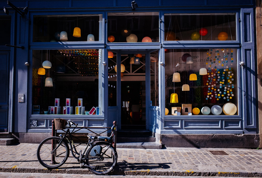 blue storefront with bike parked in front