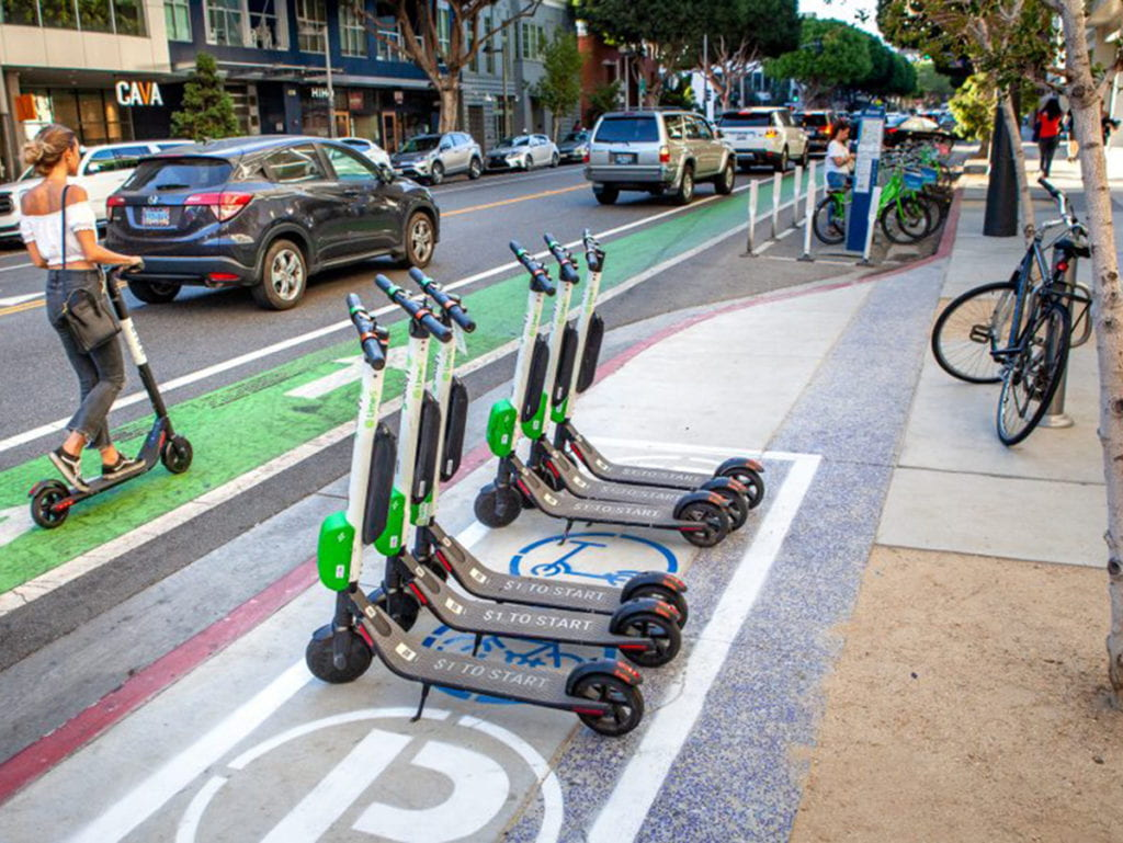 electric scooters parked on a sidewalk