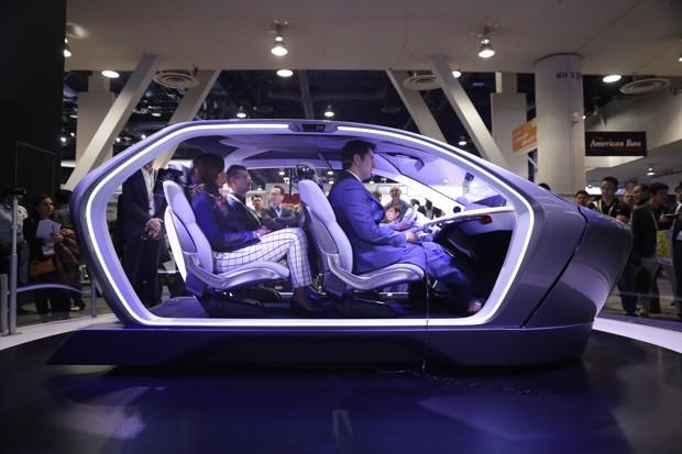 people sitting in self driving car