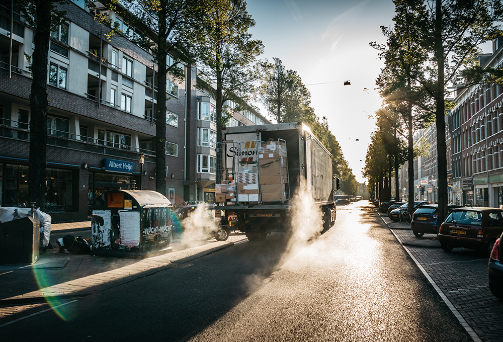 Delivery truck on city street at sunrise