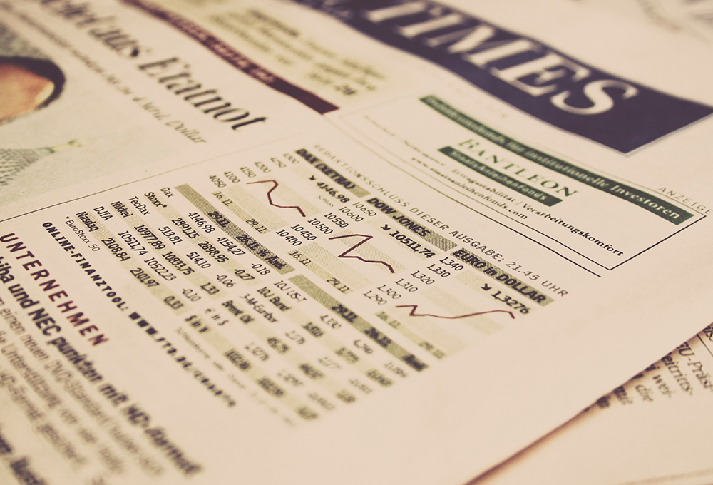 Close up of newspaper page with stock market graph