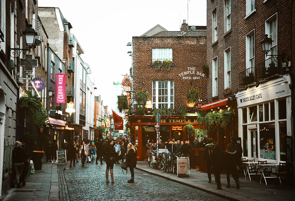 Busy pedestrian street lined with shops and restaurants in Dublin