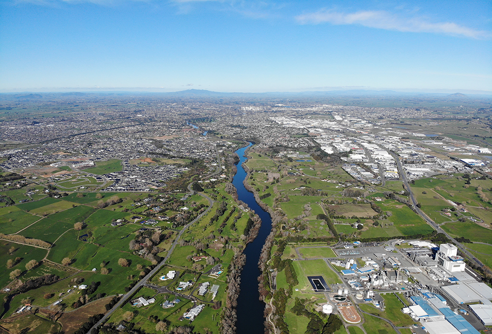 Aerial view of Waikato River Trail in New Zealand showing change in urban density