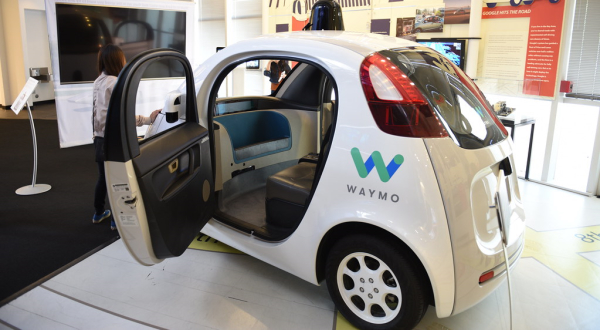 Waymo autonomous car with door open inside a showroom