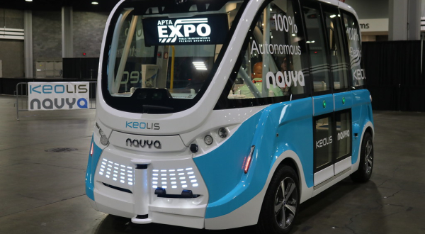 Self-driving minibus parked in show room